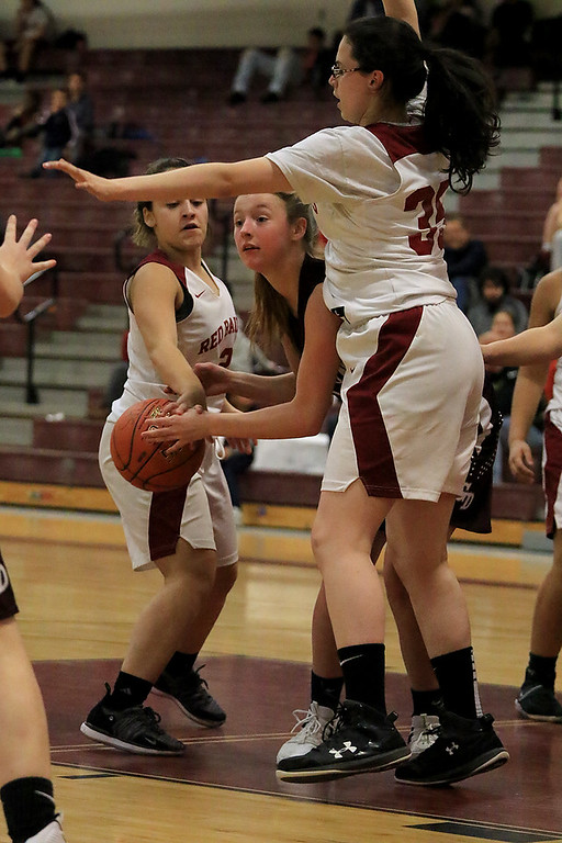 . Groton Dunstable Regional High School girls basketball made it\'s way to Fitchburg to play Fitchburg High School on Friday night, January 18, 2019. FHS\'s Aleysha Santos gets her hands on the ball and knocks it away from GDRHS\'s Emily Smith as she is being covered by FHS\'s Siena Armano. SENTINEL & ENTERPRISE/JOHN LOVE