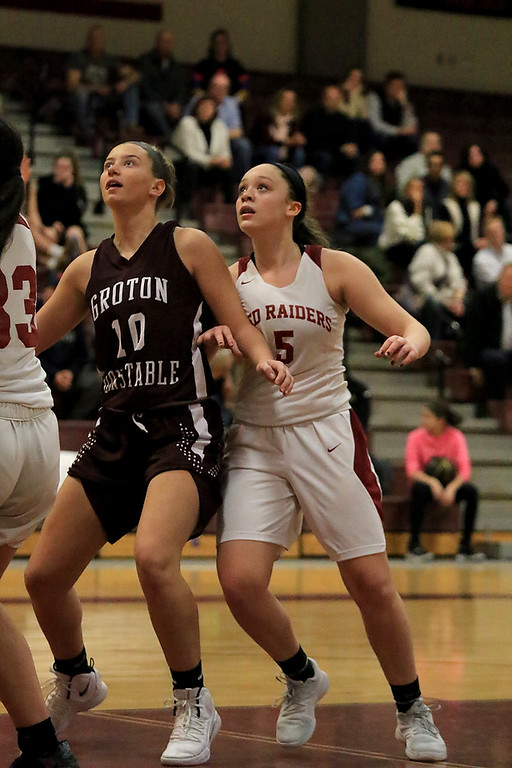 . Groton Dunstable Regional High School girls basketball made it\'s way to Fitchburg to play Fitchburg High School on Friday night, January 18, 2019. GDRHS\'s Rachel Erickson and FHS\'s Madyson Jarrett fight for position under the net during a free throw. Groton-Dunstable won, 50-28. SENTINEL & ENTERPRISE/JOHN LOVE