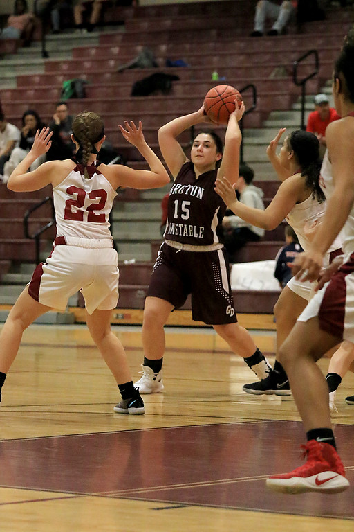 . Groton Dunstable Regional High School girls basketball made it\'s way to Fitchburg to play Fitchburg High School on Friday night, January 18, 2019. GDRHS\'s Katherine Eberhardt looks for a teammate to pass to during the game. SENTINEL & ENTERPRISE/JOHN LOVE