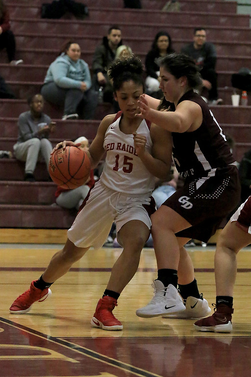 . Groton Dunstable Regional High School girls basketball made it\'s way to Fitchburg to play Fitchburg High School on Friday night, January 18, 2019. FHS\'s Diandra Bodie tries to take the ball down the baseline to the hoop by GDRHS\'s Katherine Eberhardt. SENTINEL & ENTERPRISE/JOHN LOVE