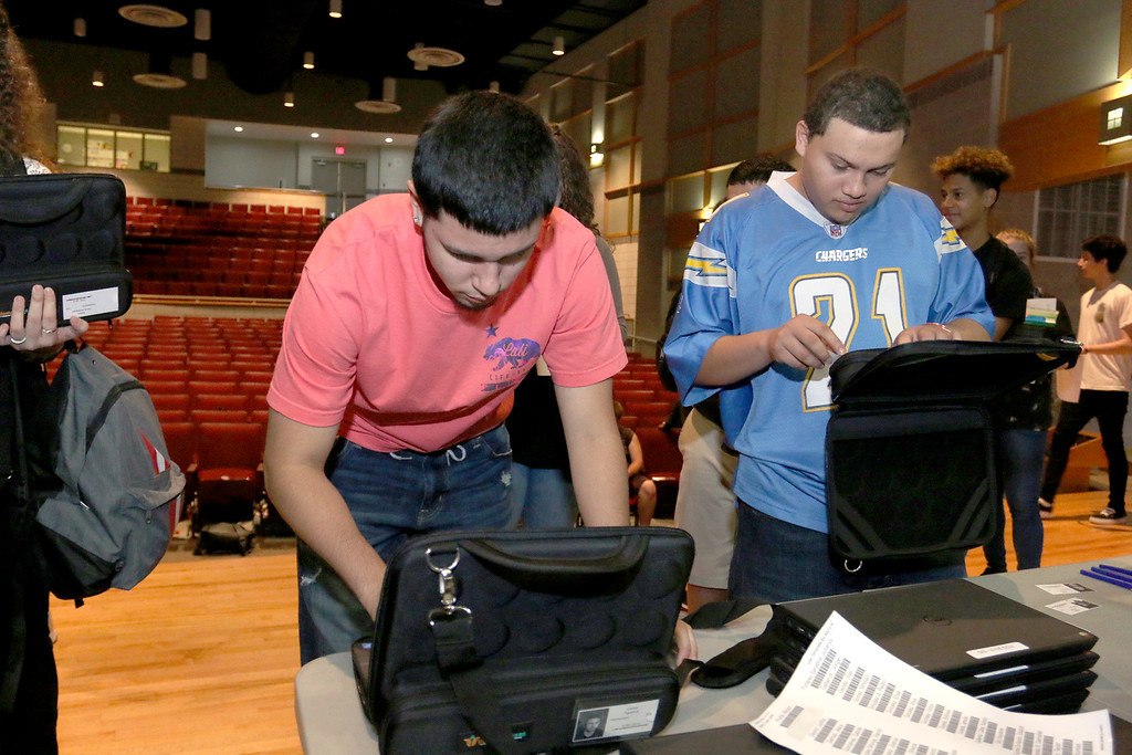 . The junior class at Fitchburg High School got Chromebook laptops on Thursday morning, September 14, 2017. Looking over their computers are Carlos Figueroa and Saul Figueroa Rivera, on right. SENTINEL& ENTERPRISE/JOHN LOVE