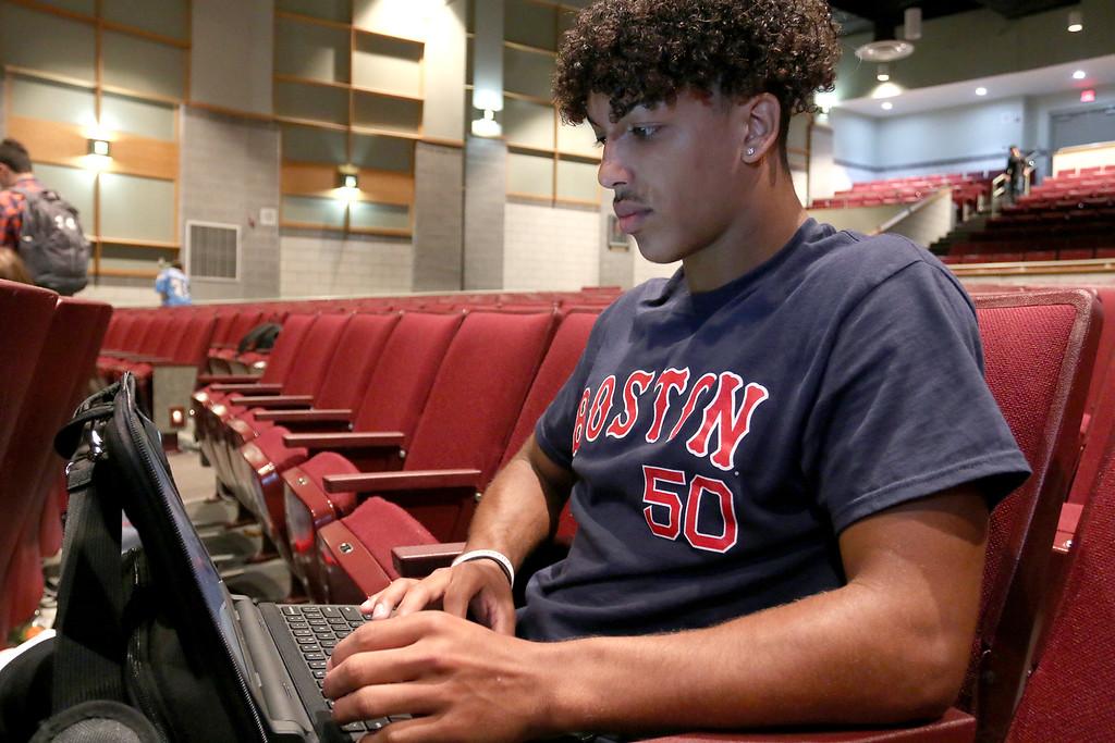 . The junior class at Fitchburg High School got Chromebook laptops on Thursday morning, September 14, 2017. Checking out his new laptop is junior Devin Deleon. SENTINEL& ENTERPRISE/JOHN LOVE