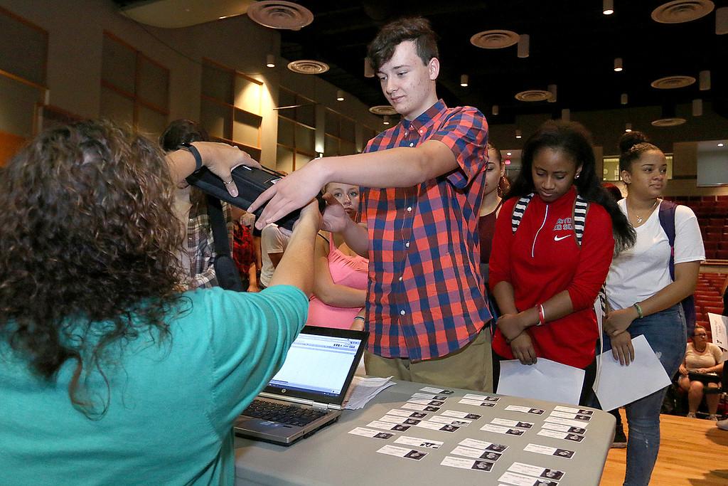 . The junior class at Fitchburg High School got Chromebook laptops on Thursday morning, September 14, 2017. Junior Jacob Davis gets his new computer. SENTINEL& ENTERPRISE/JOHN LOVE