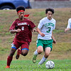 Fitchburg High School boys soccer played Clinton High School on Thursday, October 4, 2018. FH's Nasih Thomas and CHS's Elijah Burk chase down the ball. SENTINEL & ENTERPRISE/JOHN LOVE