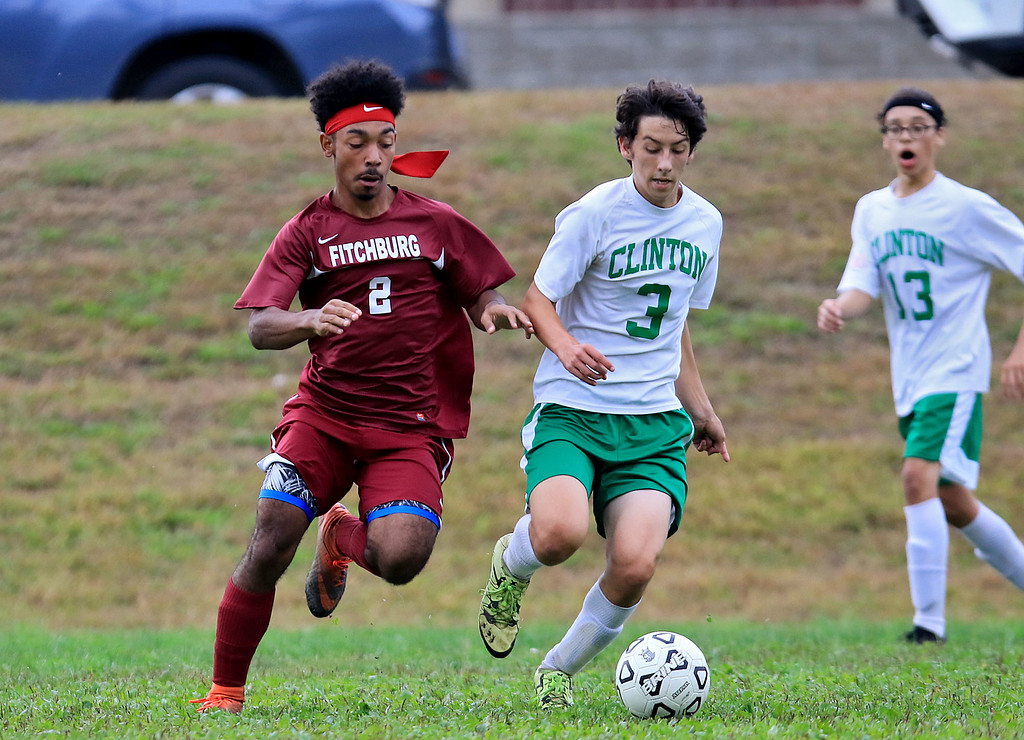 . Fitchburg High School boys soccer played Clinton High School on Thursday, October 4, 2018. FH\'s Nasih Thomas and CHS\'s Elijah Burk chase down the ball. SENTINEL & ENTERPRISE/JOHN LOVE