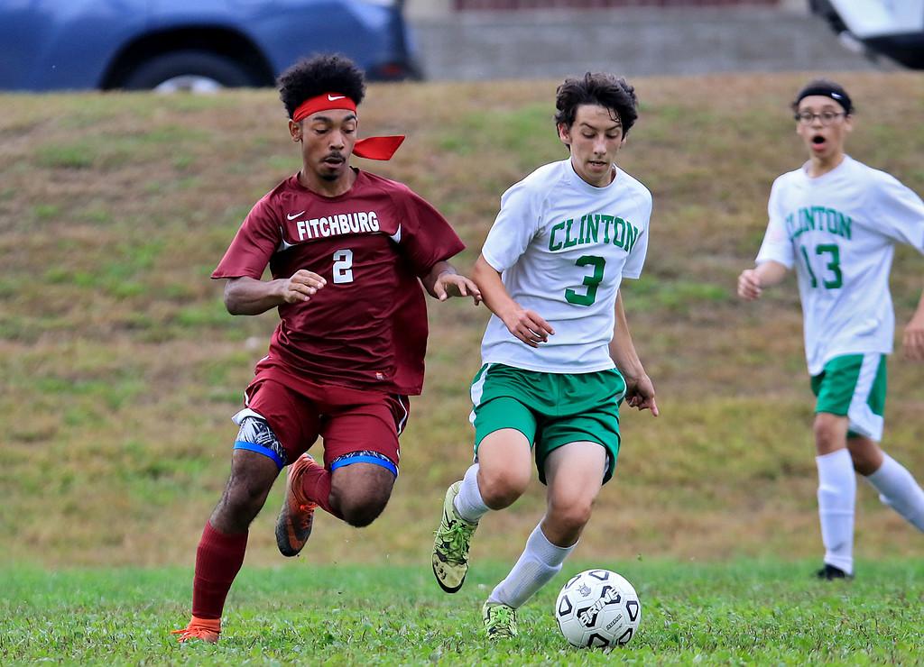 . Fitchburg High School boys soccer played Clinton High School on Thursday, October 4, 2018. FH\'s Nasih Thomas and CHS\'s Elijah Burk chase down the ball. SENTINEL & ENTERPRISE/JOHN LOVE