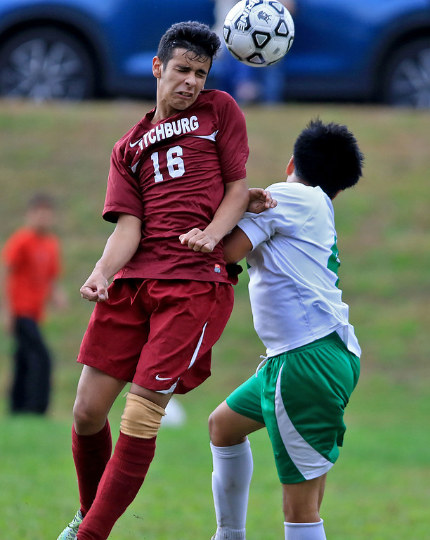 . Fitchburg High School boys soccer played Clinton High School on Thursday, October 4, 2018. FHS\'s Miguel Silvera goes over a CHS player to head the ball. SENTINEL & ENTERPRISE/JOHN LOVE