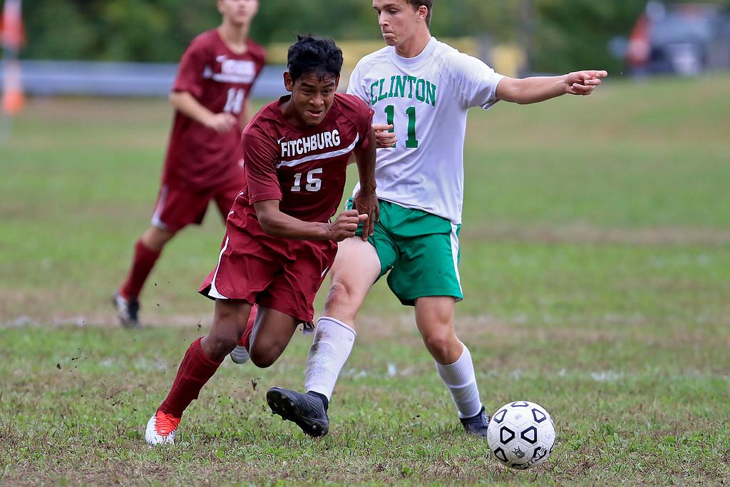. Fitchburg High School boys soccer played Clinton High School on Thursday, October 4, 2018. FHS\'s Williams Martinez tries to get by CHS\'s Chris Heinsohn-Roe. SENTINEL & ENTERPRISE/JOHN LOVE