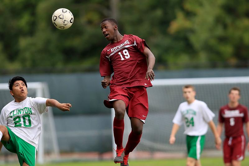Fitchburg High School boys soccer played Clinton High School on Thursday, October 4, 2018. FHS's Edwin Daramy heads the ball. SENTINEL & ENTERPRISE/JOHN LOVE