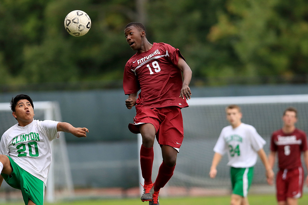 . Fitchburg High School boys soccer played Clinton High School on Thursday, October 4, 2018. FHS\'s Edwin Daramy heads the ball. SENTINEL & ENTERPRISE/JOHN LOVE