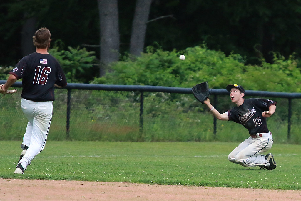 . Fitchburg High School played Groton Dunstable Regional High School on Thursday afternoon in the Central Mass. Division 1 first round. GDRHS outfielder Doug Tompkins makes a sliding catch. SENTINEL & ENTERPRISE/JOHN LOVE