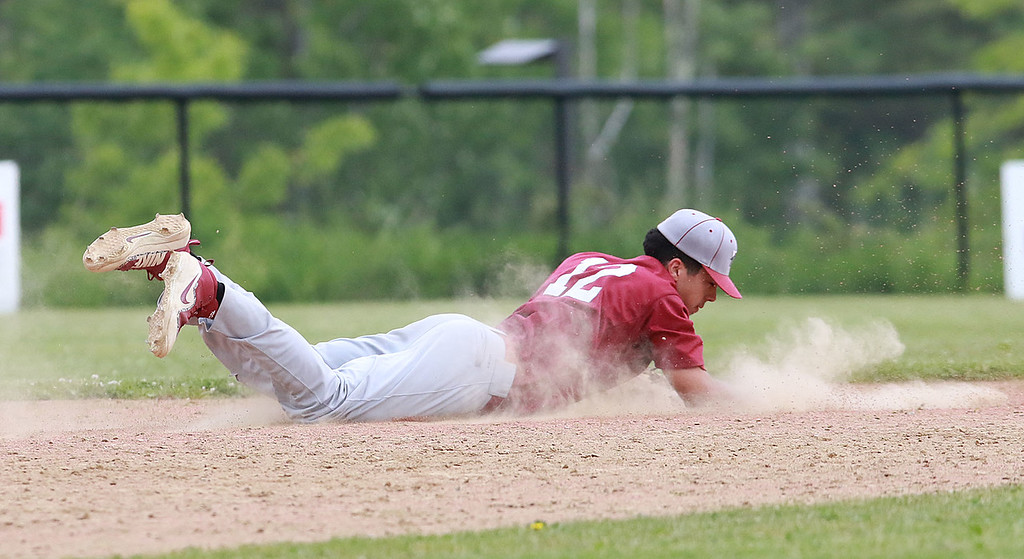 . Fitchburg High School played Groton Dunstable Regional High School on Thursday afternoon in the Central Mass. Division 1 first round. FHS\'s Anthony Silverio dives for a ground ball. SENTINEL & ENTERPRISE/JOHN LOVE