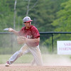 Fitchburg High School played Groton Dunstable Regional High School on Thursday afternoon in the Central Mass. Division 1 first round. FHS's Anthony Silverio goes to throw the ball from his knees after diving for a ground ball. SENTINEL & ENTERPRISE/JOHN LOVE