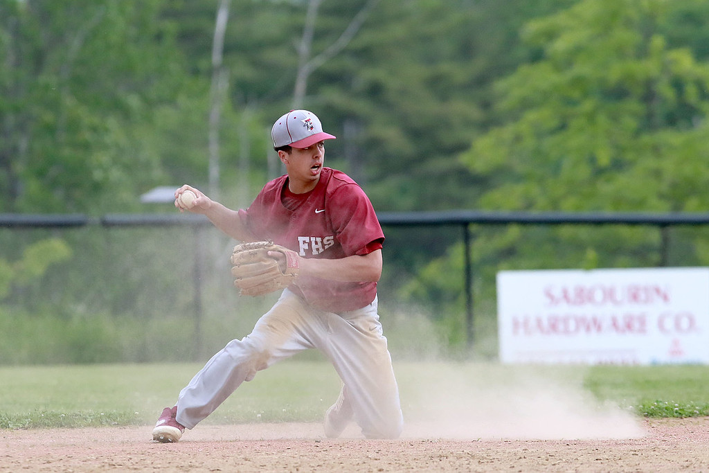 . Fitchburg High School played Groton Dunstable Regional High School on Thursday afternoon in the Central Mass. Division 1 first round. FHS\'s Anthony Silverio goes to throw the ball from his knees after diving for a ground ball. SENTINEL & ENTERPRISE/JOHN LOVE