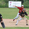 Fitchburg High School played Groton Dunstable Regional High School on Thursday afternoon in the Central Mass. Division 1 first round. GDRHS player Doug Tompkins leads off second. behind him is FHS's shortstop Anthony Silverio. SENTINEL & ENTERPRISE/JOHN LOVE