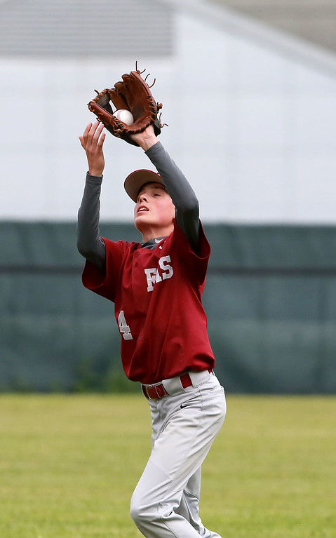 . Fitchburg High School played Groton Dunstable Regional High School on Thursday afternoon in the Central Mass. Division 1 first round. FHS\'s Zach Scott makes a catch on the edge of the infield. SENTINEL & ENTERPRISE/JOHN LOVE