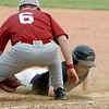 Fitchburg High School played Groton Dunstable Regional High School on Thursday afternoon in the Central Mass. Division 1 first round. GDRHS's Brendan Cronin dives back to first before FHS's Sammy Robichaud could tag him. SENTINEL & ENTERPRISE/JOHN LOVE