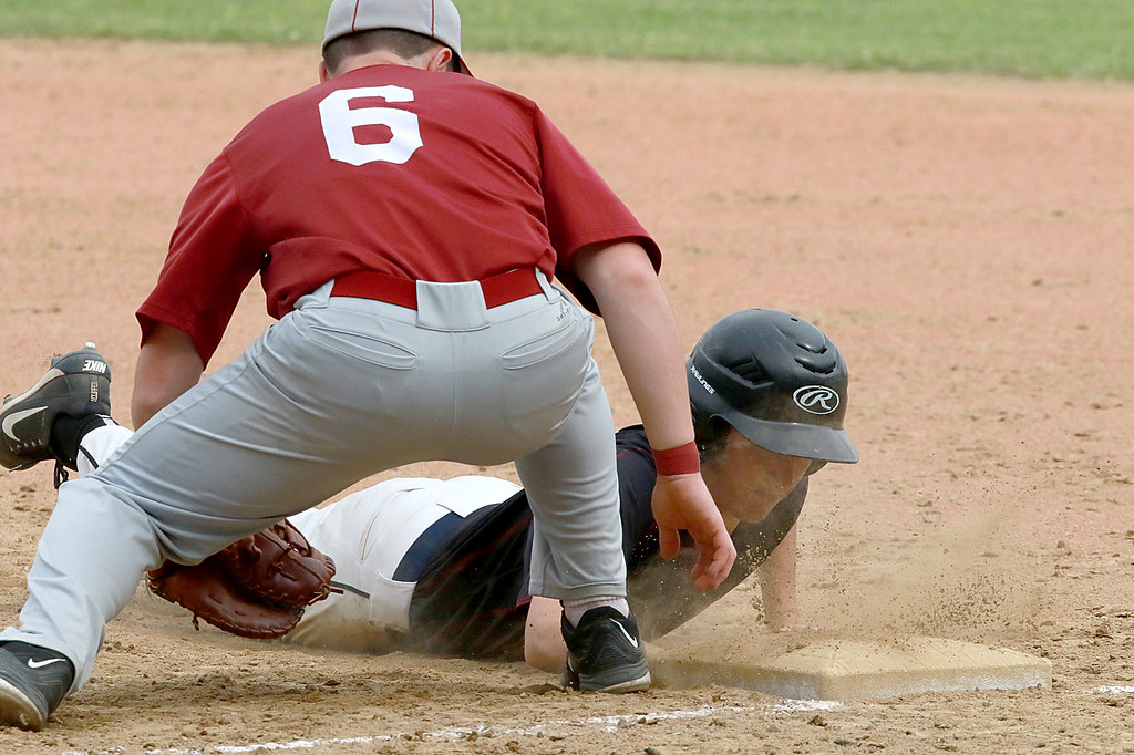 . Fitchburg High School played Groton Dunstable Regional High School on Thursday afternoon in the Central Mass. Division 1 first round. GDRHS\'s Brendan Cronin dives back to first before FHS\'s Sammy Robichaud could tag him. SENTINEL & ENTERPRISE/JOHN LOVE