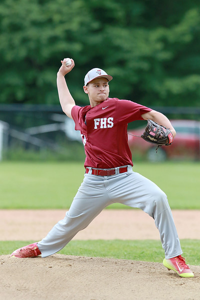 Fitchburg High School played Groton Dunstable Regional High School on Thursday afternoon in the Central Mass. Division 1 first round. FHS pitcher Anthony Cuevas winds up to deliver a pitch. SENTINEL & ENTERPRISE/JOHN LOVE