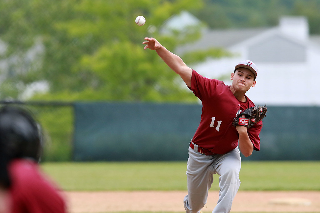 . Fitchburg High School played Groton Dunstable Regional High School on Thursday afternoon in the Central Mass. Division 1 first round. FHS pitcher Anthony Cuevas winds up to deliver a pitch. SENTINEL & ENTERPRISE/JOHN LOVE