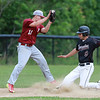 Fitchburg High School played Groton Dunstable Regional High School on Thursday afternoon in the Central Mass. Division 1 first round. GDRHS's Shamus Gelinas slides into third before the tag from FHS's Anthony Cuevas. SENTINEL & ENTERPRISE/JOHN LOVE