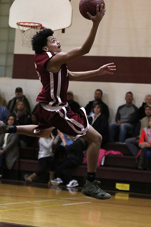 . Fitchburg High School player Mendes Morrison goes up for a shot in their game against Groton Dunstable High School on Tuesday night. SENTINEL & ENTERPRISE/JOHN LOVE