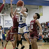Leominster high School boys basketball played Fitchburg High School on Tuesday night in Leominster, Feb. 4, 2020. LHS's #10 Treyvon LeBlanc tries to get by FHS's #2 Donovan Deleon and FHS's #10 Monty Graham. SENTINEL & ENTERPRISE/JOHN LOVE