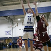 Leominster high School boys basketball played Fitchburg High School on Tuesday night in Leominster, Feb. 4, 2020. LHS's #11 liam Connacher tries to put up a shot over FHS's #0 Gabriel Rivera. SENTINEL & ENTERPRISE/JOHN LOVE