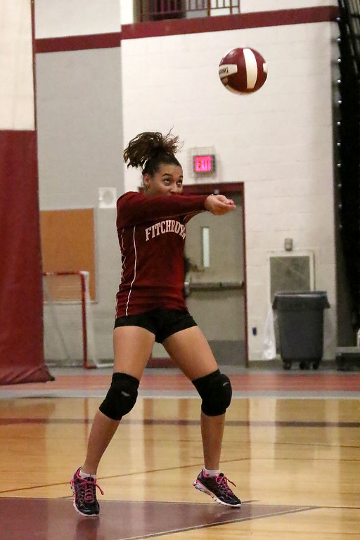 . Fitchburg High School played Leominster High School volleyball on Tuesday afternoon in Fitchburg. FHS\'s Dyalisha Deleon sets the ball during action in the game. SENTINEL & ENTERPRISE/JOHN LOVE
