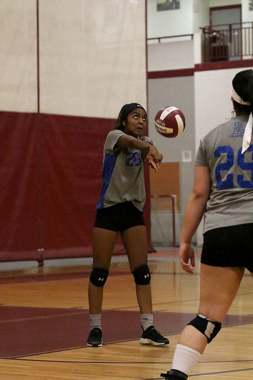 . Fitchburg High School played Leominster High School volleyball on Tuesday afternoon in Fitchburg. LHS\'sJonielys Pinto sets the ball during action in the game.   SENTINEL & ENTERPRISE/JOHN LOVE