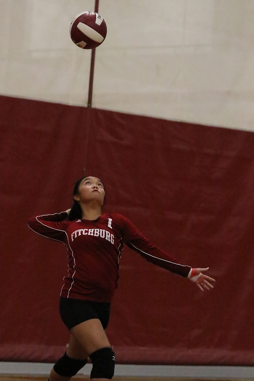. Fitchburg High School played Leominster High School volleyball on Tuesday afternoon in Fitchburg. FHS\'s Megan Duong serves the ball during action in the game. SENTINEL & ENTERPRISE/JOHN LOVE