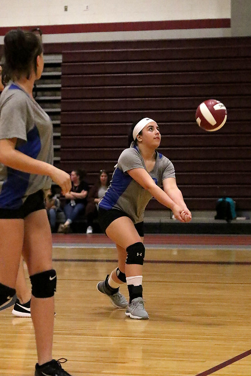 . Fitchburg High School played Leominster High School volleyball on Tuesday afternoon in Fitchburg. Leominster High School\'s Gabriela Guzman sets the ball during action in the game. SENTINEL & ENTERPRISE/JOHN LOVE