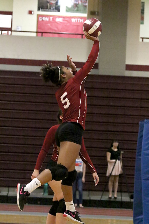 . Fitchburg High School played Leominster High School volleyball on Tuesday afternoon in Fitchburg. FHS\'s Diandra Boddie hits the ball over the net during action in the game. SENTINEL & ENTERPRISE/JOHN LOVE