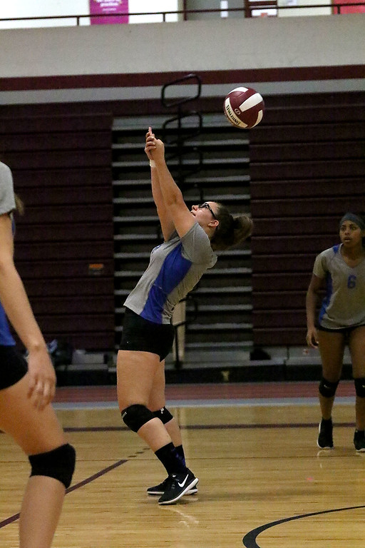 . Fitchburg High School played Leominster High School volleyball on Tuesday afternoon in Fitchburg. LHS\'s Hailey McGinnis sets the ball during action in the game. SENTINEL & ENTERPRISE/JOHN LOVE
