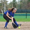 Lunenburg Middle High School softball played Fitchburg High School in Fitchburg Friday afternoon, May 4, 2018. LMHS player Sierra Champagne pick up a ground ball during action in the game. SENTINEL & ENTERPRISE/JOHN LOVE