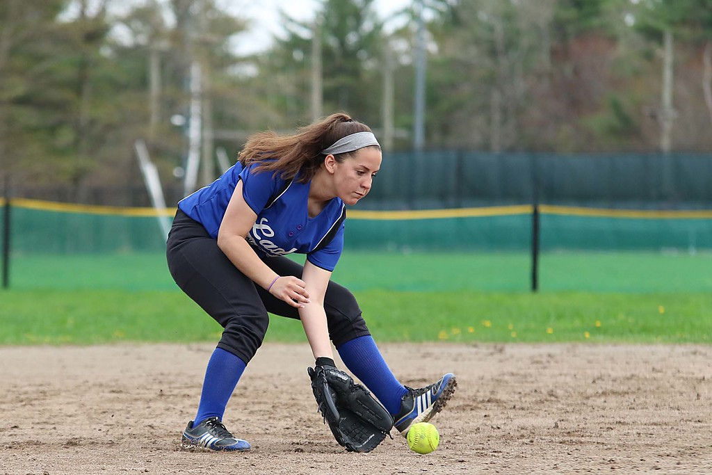 . Lunenburg Middle High School softball played Fitchburg High School in Fitchburg Friday afternoon, May 4, 2018. LMHS player Sierra Champagne pick up a ground ball during action in the game. SENTINEL & ENTERPRISE/JOHN LOVE
