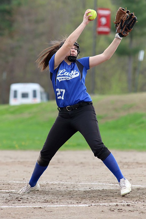 . Lunenburg Middle High School softball played Fitchburg High School in Fitchburg Friday afternoon, May 4, 2018. LMHS pitcher Leah Sowerbutts winds up to deliver a pitch during action in the game.  Lunenburg won, 9-6. SENTINEL & ENTERPRISE/JOHN LOVE