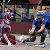 Lunenburg Middle High School softball played Fitchburg High School in Fitchburg Friday afternoon, May 4, 2018. LMHS catcher Jillian Defrancescoget read to tag FHS's Emma Auger who was trying to steal home. SENTINEL & ENTERPRISE/JOHN LOVE