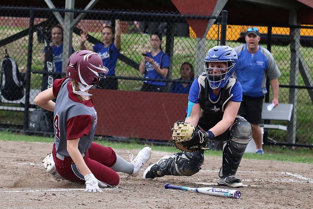. Lunenburg Middle High School softball played Fitchburg High School in Fitchburg Friday afternoon, May 4, 2018. LMHS catcher Jillian Defrancescoget read to tag FHS\'s Emma Auger who was trying to steal home. SENTINEL & ENTERPRISE/JOHN LOVE