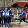 Lunenburg Middle High School softball played Fitchburg High School in Fitchburg Friday afternoon, May 4, 2018. LMHS player Sarah Morse gets read to leap on home plate while her teammates wait to congratulate her on her home run. SENTINEL & ENTERPRISE/JOHN LOVE
