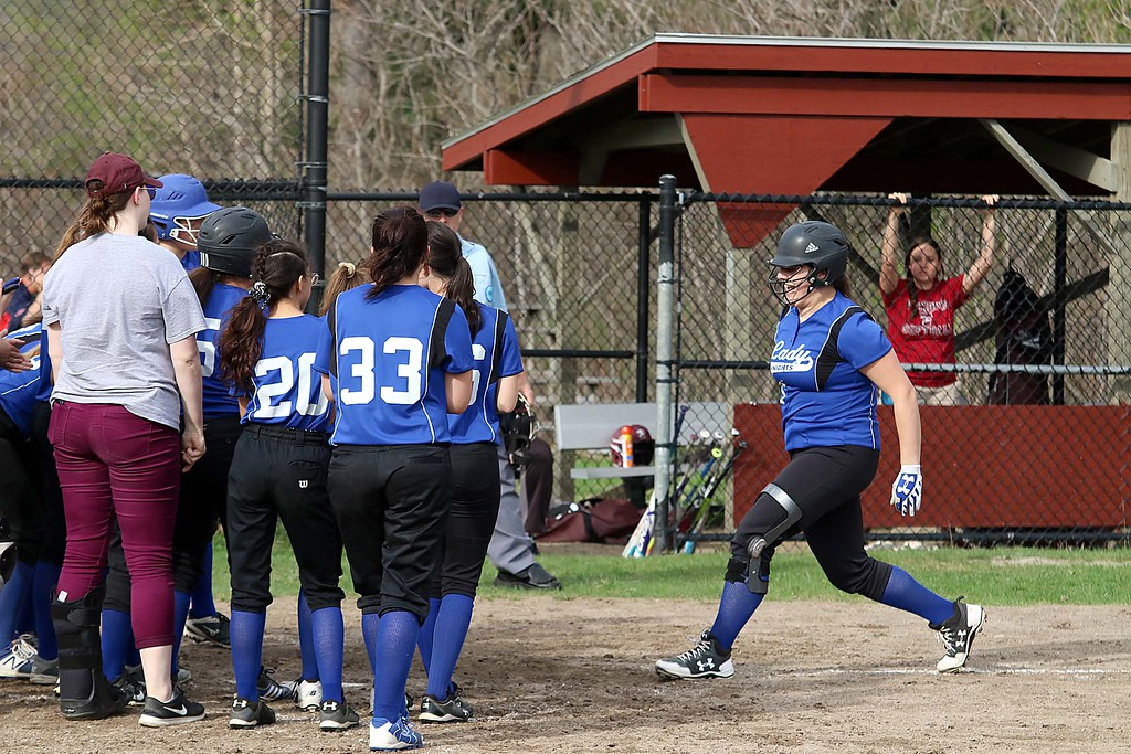 . Lunenburg Middle High School softball played Fitchburg High School in Fitchburg Friday afternoon, May 4, 2018. LMHS player Sarah Morse gets read to leap on home plate while her teammates wait to congratulate her on her home run. SENTINEL & ENTERPRISE/JOHN LOVE