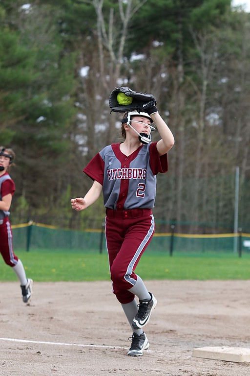 . Lunenburg Middle High School softball played Fitchburg High School in Fitchburg Friday afternoon, May 4, 2018. FHS\'s third baseman Lainey Jaramillo makes a nice catch after a pop up in the infield during action in the game. SENTINEL & ENTERPRISE/JOHN LOVE