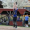 Lunenburg Middle High School softball played Fitchburg High School in Fitchburg Friday afternoon, May 4, 2018. LMHS catcher Jillian Defrancesco leaps to get a through as FHS's Emma Auger tries to steal home. SENTINEL & ENTERPRISE/JOHN LOVE