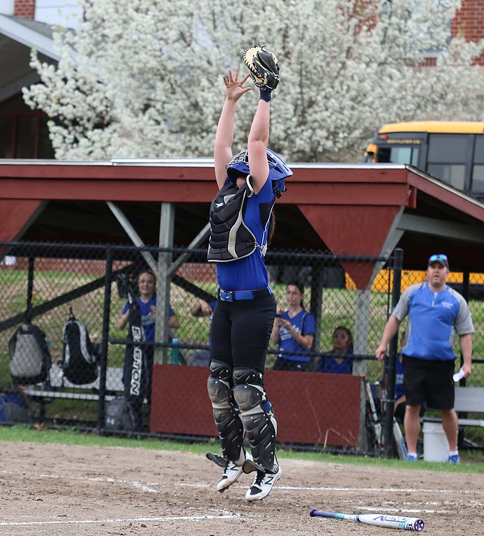 . Lunenburg Middle High School softball played Fitchburg High School in Fitchburg Friday afternoon, May 4, 2018. LMHS catcher Jillian Defrancesco leaps to get a through as FHS\'s Emma Auger tries to steal home. SENTINEL & ENTERPRISE/JOHN LOVE