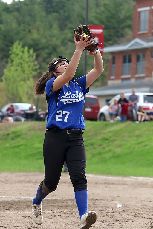. Lunenburg Middle High School softball played Fitchburg High School in Fitchburg Friday afternoon, May 4, 2018. LMHS pitcher Leah Sowerbutts makes a nice catch after a pop in the infield up during action in the game . SENTINEL & ENTERPRISE/JOHN LOVE