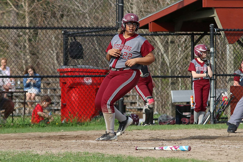 . Lunenburg Middle High School softball played Fitchburg High School in Fitchburg Friday afternoon, May 4, 2018. FHS\'s Liliana Encarnacion scores a run during action in the game. SENTINEL & ENTERPRISE/JOHN LOVE