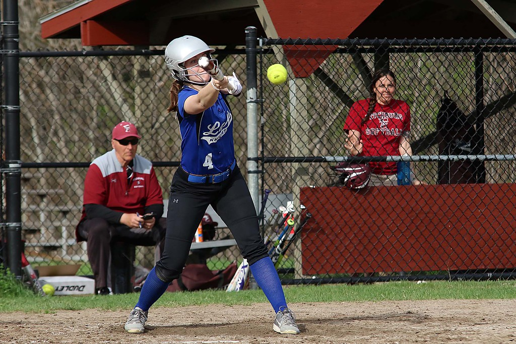 . Lunenburg Middle High School softball played Fitchburg High School in Fitchburg Friday afternoon, May 4, 2018. LMHS player Olivia Proctor tries to bunt during action in the game. SENTINEL & ENTERPRISE/JOHN LOVE