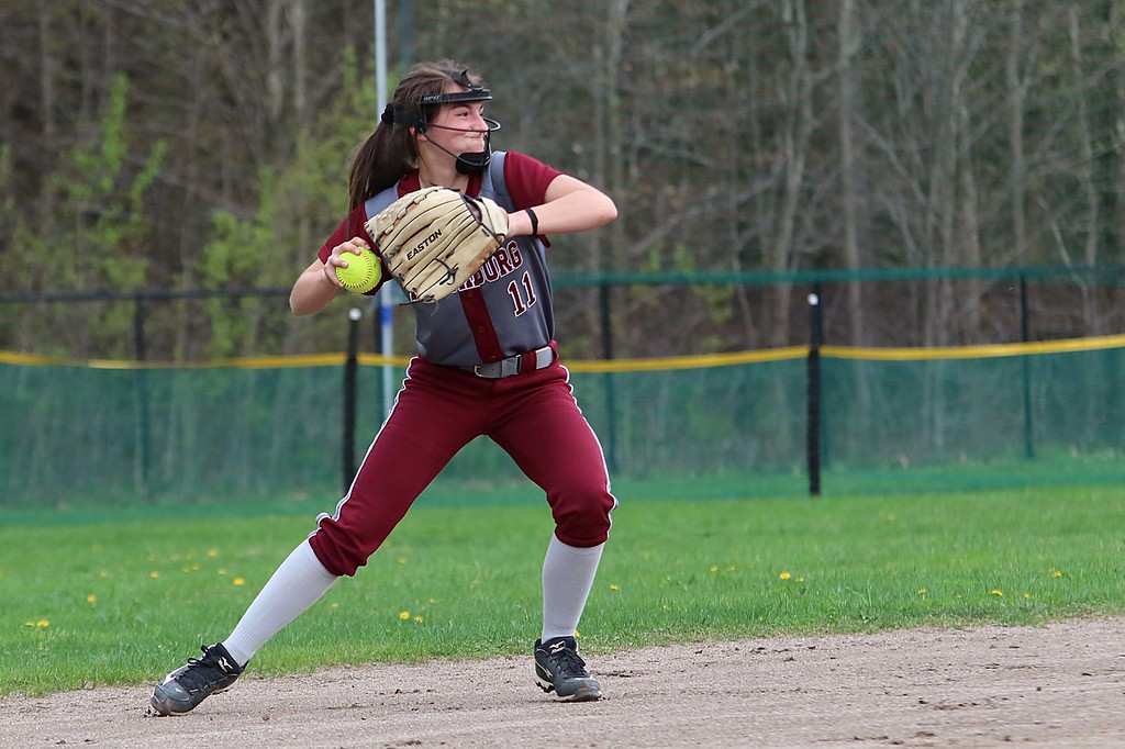 . Lunenburg Middle High School softball played Fitchburg High School in Fitchburg Friday afternoon, May 4, 2018. FHS\'s Kammarie Pelland gets read to throw to first after picking up a ground ball during action in the game. SENTINEL & ENTERPRISE/JOHN LOVE