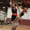 North Middlesex Regional High School boys basketball visited Fitchburg High School on Friday night, Jan. 3, 2020. NM's #1 Jake Richard drive into FHS's #0 Gabriel Rivera as FHS's #3 Jorge Gaitan reaches to try and stop him. SENTINEL & ENTERPRISE/JOHN LOVE