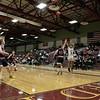 North Middlesex Regional High School boys basketball visited Fitchburg High School on Friday night, Jan. 3, 2020. NM's #23 Ryan Mcgrath tries to stop a three point shot by FHS's #3 Jorge Gaitan. SENTINEL & ENTERPRISE/JOHN LOVE